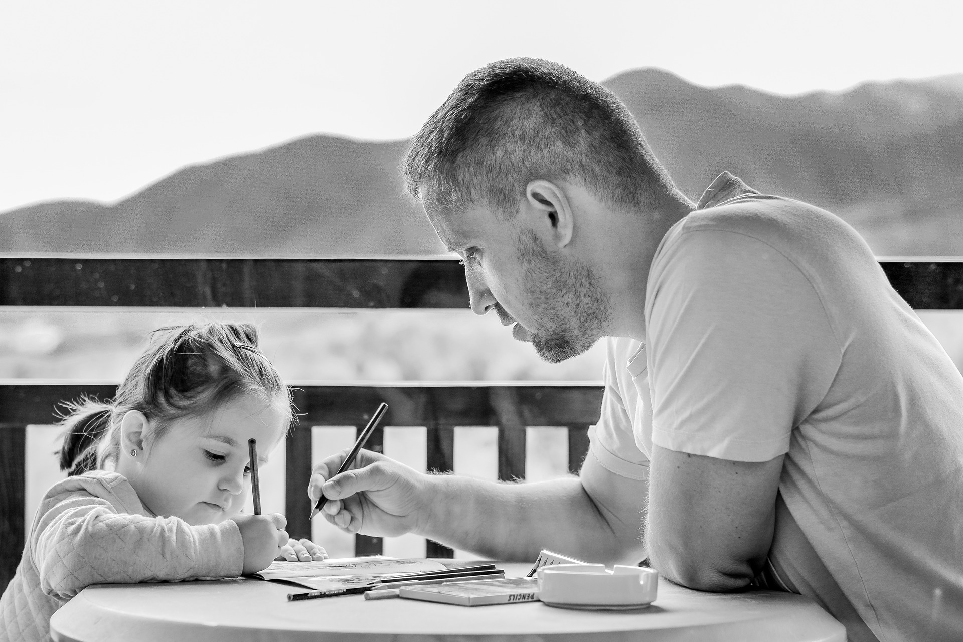 dad and girl writing